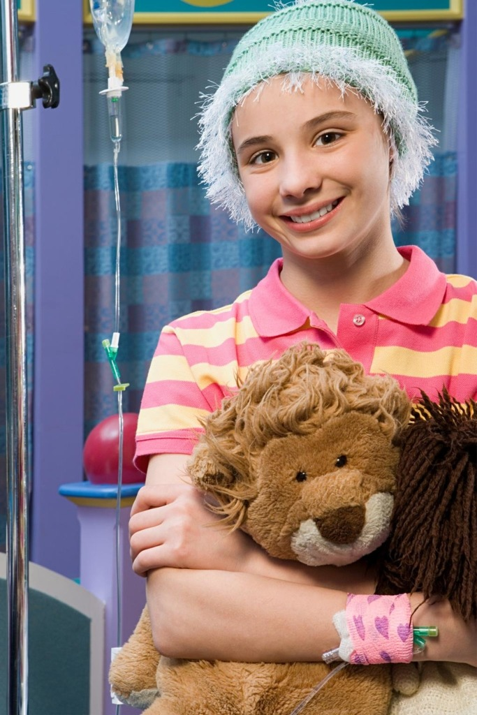 A girl holding a stuffed lion